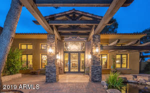 GRAND ENTRANCE COURTYARD. PAVERS. STACKED STONE COLUMNS. BEAMS. KOI POND