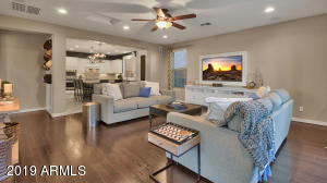 Kitchen open to the family room with wood floors and view of the pool.