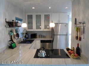 Granite countertops with matching paint all throughout the unit makes this place ready for your touch!