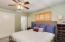 *Master bedroom w/ berber carpet + plantation shutters*