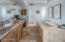 Master Bath with jacuzzi tub, ample counter space and 2 walk-in closets