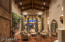Beautiful Living Room with fireplace as you enter the home with the barrel wood beamed ceiling
