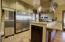 Professional kitchen inside clubhouse to host parties.
