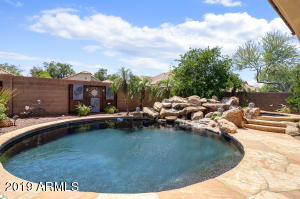 Enjoy the private backyard complete with flagstone patio and round Pebble Tec heated play pool and hot tub.
