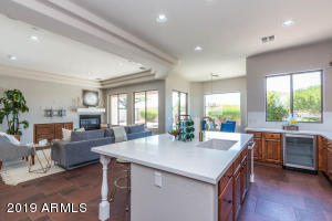 Light, bright kitchen open to family room. Enjoy views of backyard oasis with no homes behind!