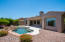 Private yard features refreshing pebble pool with waterfall and no-maintenance artificial grass