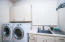 Large walk in Laundry with cabinets and sink. You do not walk through when entering the home.
