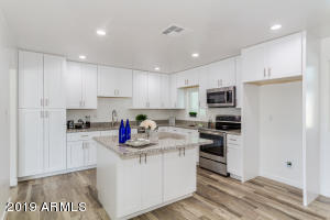 Fully remodeled kitchen - brand new cabinets, fixtures, and new GE Profile stainless steel appliances!