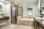 The walk in shower soaking tub, tile and travertine make this bathroom a dream!