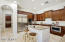 """This room will take your breath away! The build in refrigerator, double ovens and built in microwave are just a few of the many """"WOW"""" factors of this home."""