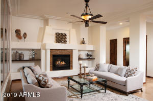 A 6,000+ sf single level home in the gated community of Los Gatos in the heart of north Scottsdale- zip code 82555. Detailed crown moldings give soaring ceilings a classic form and function.