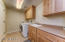 Laundry Room w/Sink & Storage Cabinets