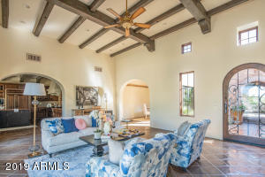 The great room with large cantera fireplace spills into the kitchen and formal dining room for effortless serving.