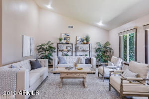 Incredible vaulted ceilings, newer dual pane windows and classic finishes in the oversized living room.