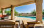The large covered patio provides ample shade and is perfect for entertaining.