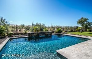 Beautiful Self-Cleaning Pebble Sheen Pool with Baja Step, pop up heads, sheer descent and
