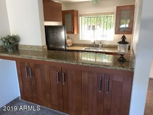 Built-in bar/eating area with granite counter tops.