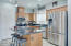 Center Island and stainless steel appliances.