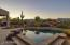 Mountain views serve as a backdrop from the pool area.