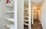 New laminate flooring and tons of shelves in this huge pantry leading from the garage to the kitchen.