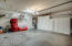 Exceptional amount of garage storage with tankless water heater and water softener.