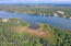 Longmere Lake Front 8.34 Acres with three rental homes, warehouse or hangar.