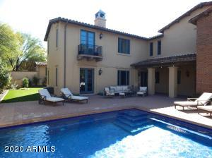 Mosaic tile pool and large patio perfect for entertaining