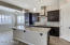 Gourmet kitchen with island breakfast bar, stainless appliances, granite counters and lots of cabinets