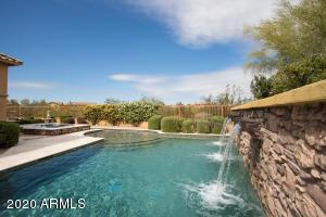 Beautiful resort style backyard, pool, spa and putting green