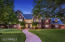 Rolling front lawns and lush, mature landscaping
