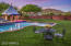 Rolling lawns, refreshing pool and open skies help create the perfect backyard