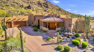The entry of this home was designed to present a strong yet gentle presence in its natural desert setting. Enormous natural rock formation with dramatic 30' water fall, and columned water feature represent the best of Arizona