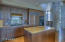 Extensive use of granite includes a range-to-cabinet splash slab of granite