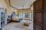Hallway open to stunning master suite