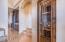 Wine closet adjacent to kitchen & formal living area