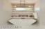 Freestanding Master Tub w designer light fixture