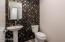 Downstairs powder bath with custom backsplash