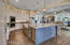 Kitchen with built-in ice maker, farmhouse sink, reverse osmosis and many more features.