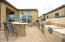Outdoor kitchen with bar area, infrared grill, full 4 burner grill, 2 burner gas cook top, refrigerator and outdoor free standing pizza oven.