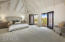 Oversize master with vaulted ceilings and leads to a large patio