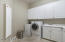 Large laundry room with counter space and storage