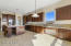 View from breakfast/informal dining area. Extended cabinets with built-in desk