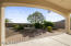 Covered patio is perfect for outdoor dining or for watching dramatic sunrises on the Estrella Mountains
