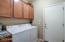 Laundry room with lots of storage and a counter.