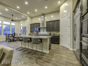 Gourmet's Dream Kitchen with Brand new unused Wolf Gas Range, GE Profile Side by Side SS Refrigerator, Houge Granite Island...