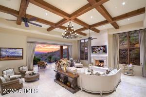 Great Room with beamed Celling, fireplace and motorized Pocket Doors