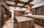 Hand-hewn beam ceiling, alder cabinetry, granite countertops.
