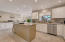 Large Kitchen with additional cabinetry with wine fridge.