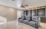Large custom book shelves in media room/ family room
