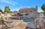 Heated pool and spa with custom water fall.